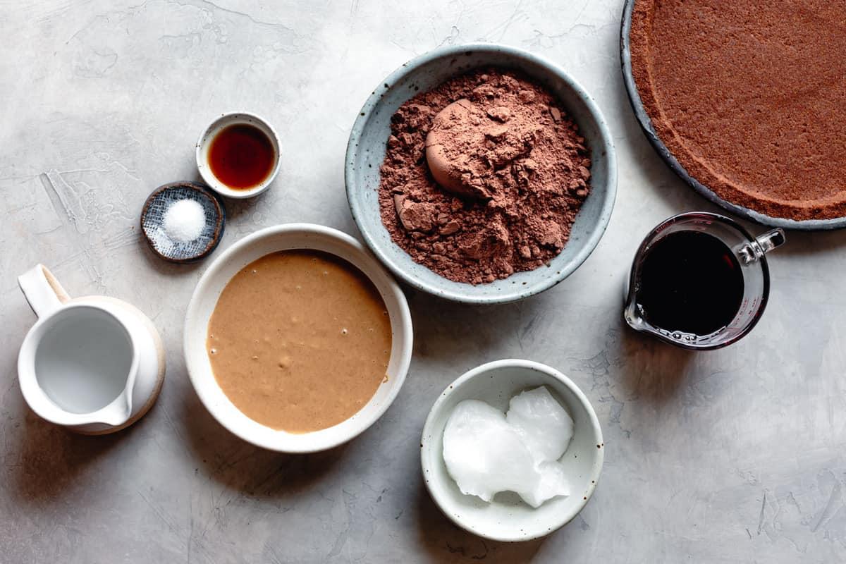 vegan chocolate pie recipe ingredients: peanut butter, water, coconut oil, salt, vanilla, cocoa, maple syrup, graham cracker crust