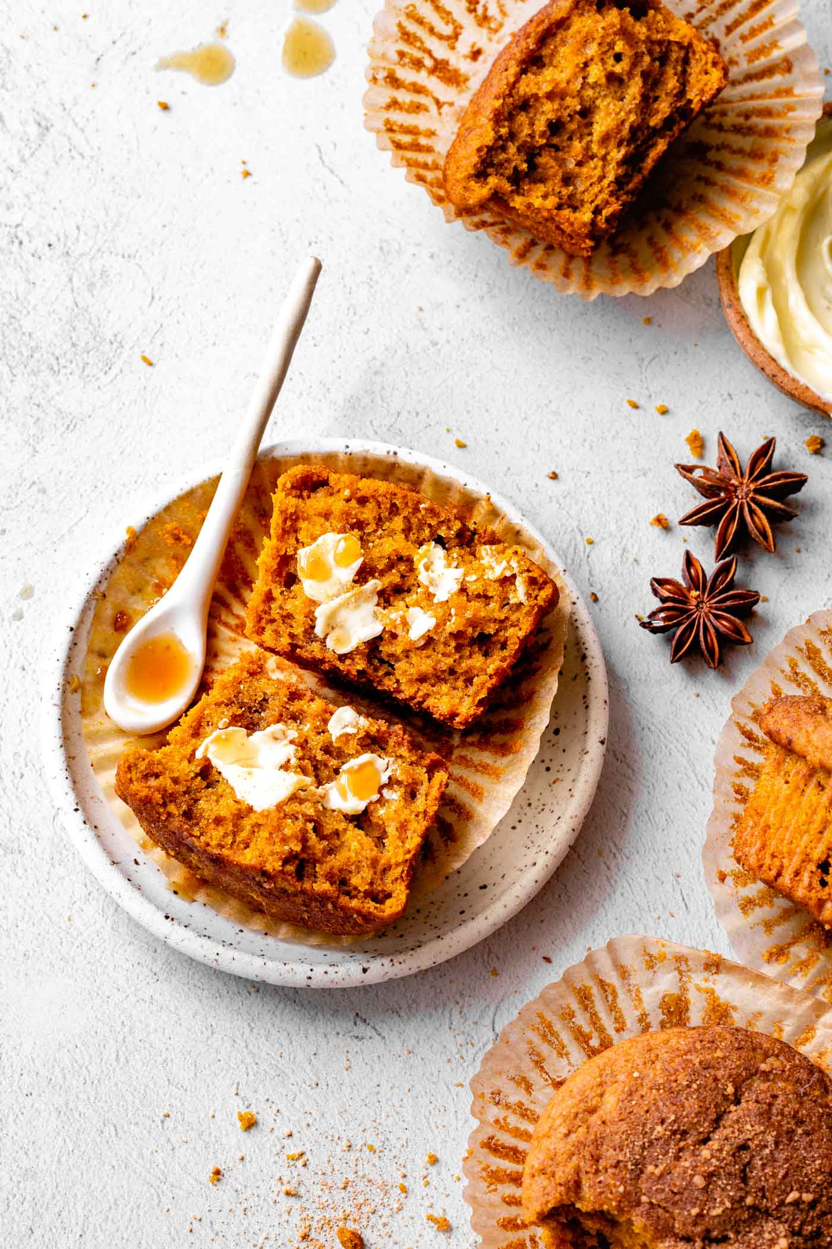 gluten-free pumpkin muffins on a rustic light gray surface looking tempting