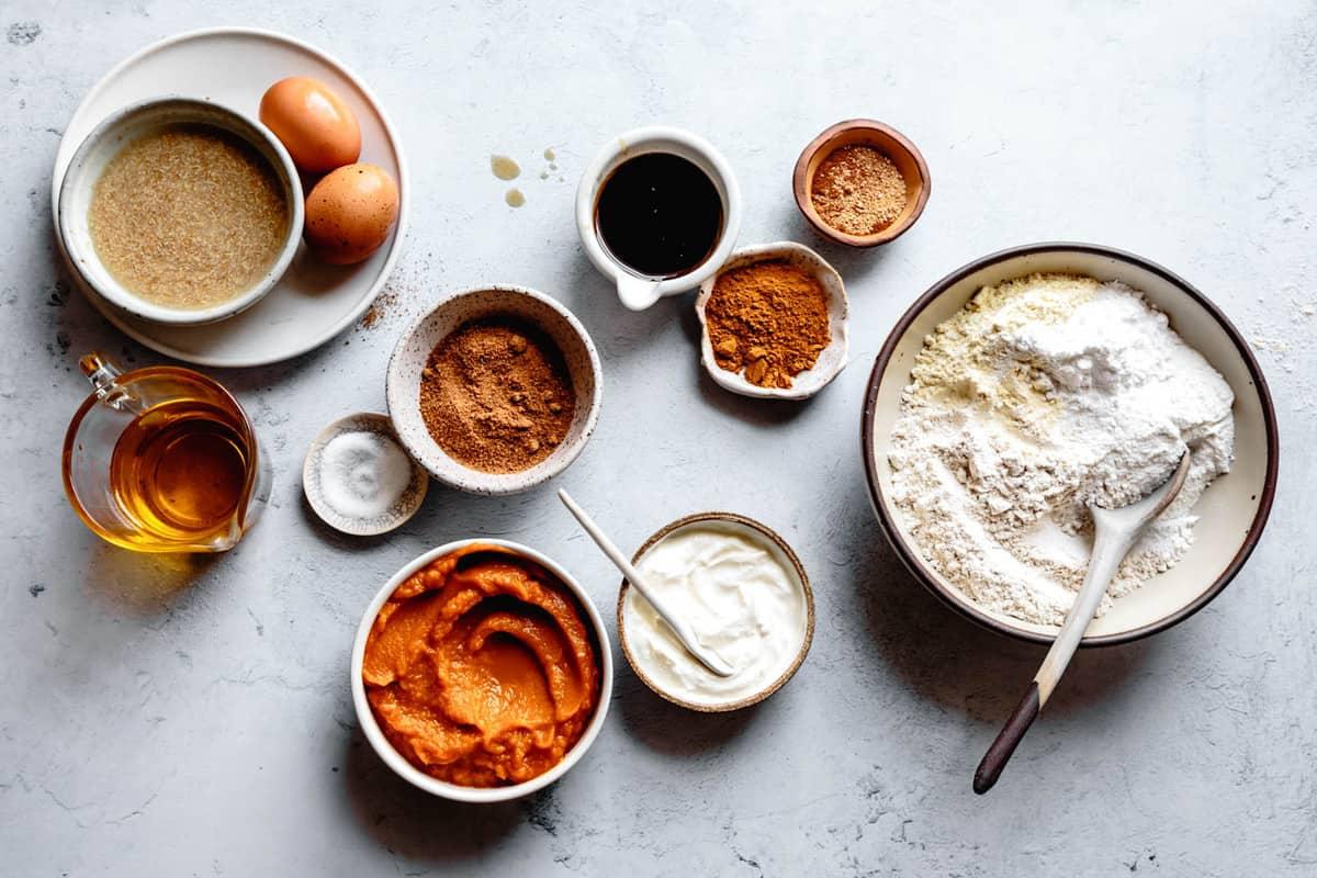 ingredients in bowls for gluten-free pumpkin muffin recipe