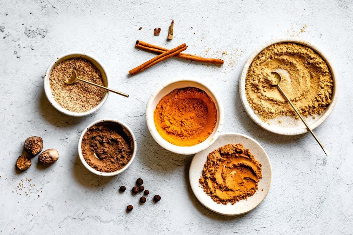 horizontal image of ground pumpkin pie spices in bowls