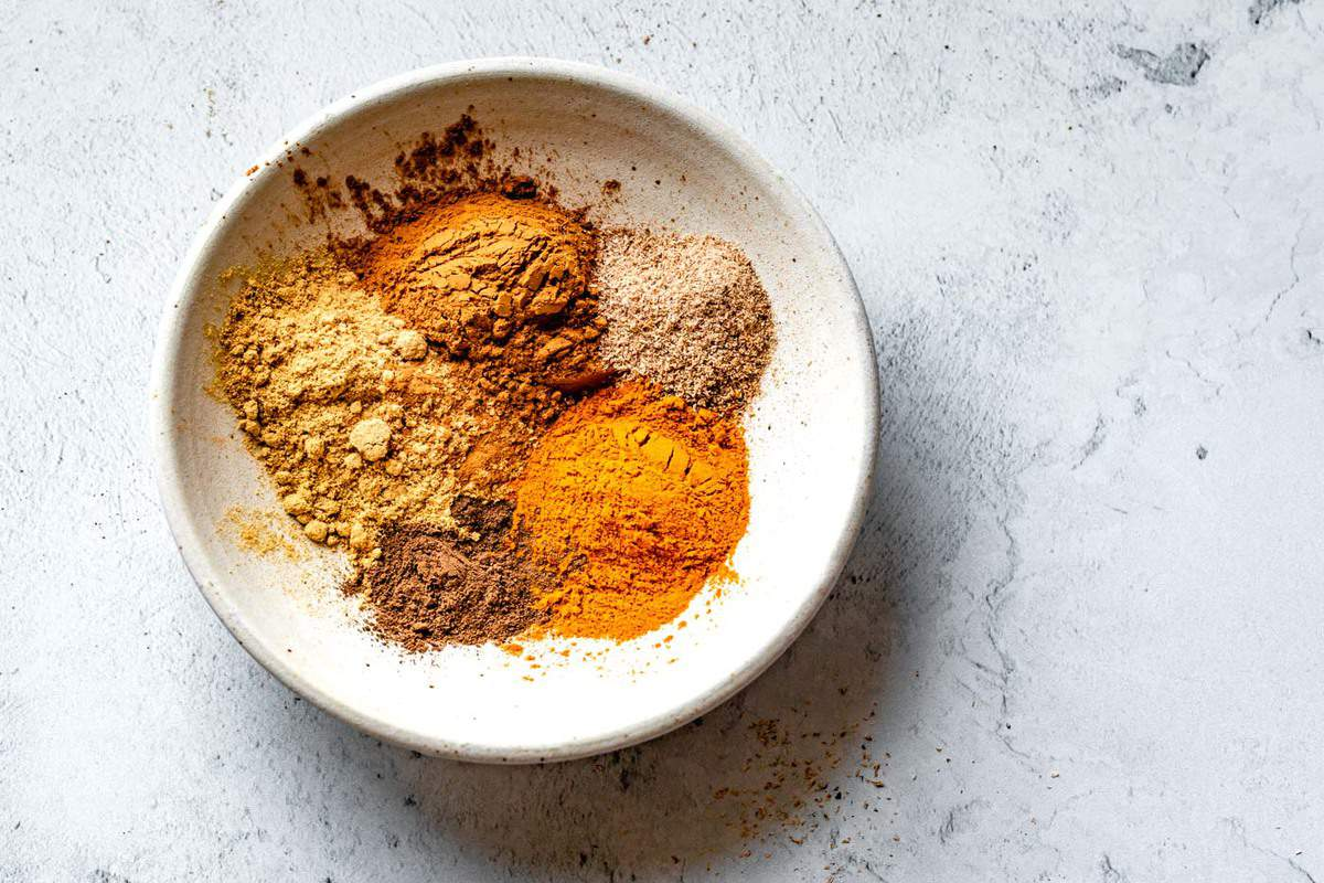 how to make homemade pumpkin spice - individual pumpkin pie spices in a white bowl